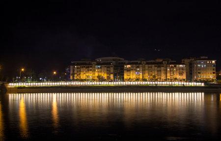 View of the night town line in Antalya Konyalti Turkey and river reflection at night time 2019-09-25 Antalya Konyalti Turkey