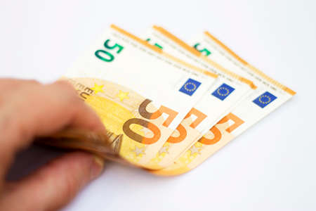 Man hold a Stack of Fifty euro banknotes laying isolated on white background
