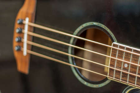 An acoustic bass guitar closeup isolated on the white background Standard-Bild