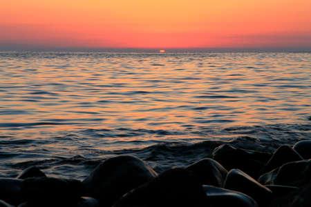 A subtropical sunset over sea. Tha Black sea seashore