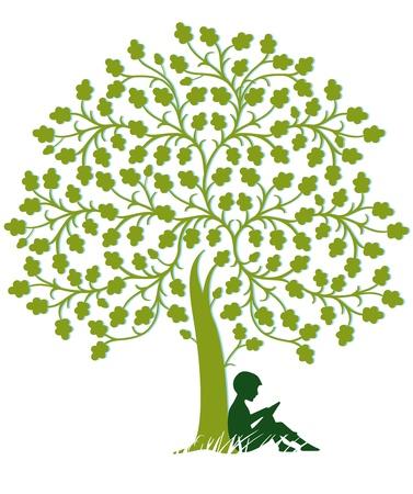 El niño está leyendo bajo un árbol