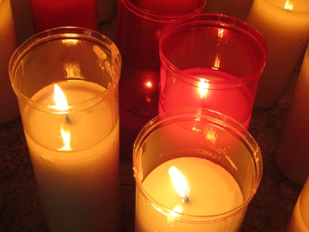 Three wax candles, white and red