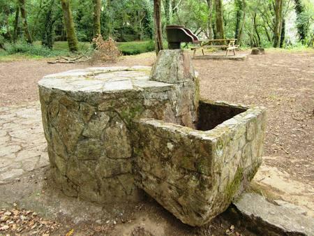 Fountain of stone water in recreation area in Sigüeiro Reklamní fotografie