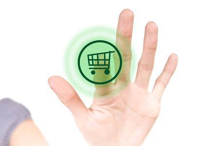 e auction: Finger pressing green buy shop button on white touchscreen