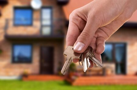 handing keys in the house background photo