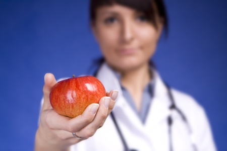 Woman Doctor Recommanding An Apple. Stock Photo - 10494804