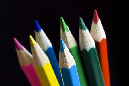Color pencils on black background. Selective focus. Stock Photo - 10490722