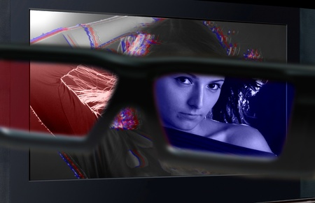 Glasses 3D in front of the TV with a woman. 3D television. photo