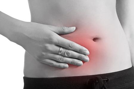 желудок: Женщина, держащая в желудке боль Фото со стока