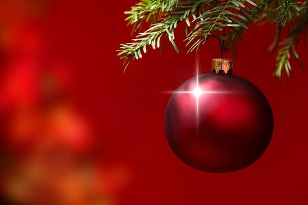 christmas  ornament: Red Christmas ornament hanging, with copy space to the left. Stock Photo