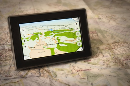 car navigation: Portable GPS for a car sitting on a map