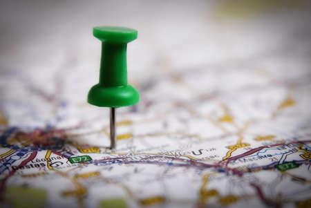 Thumbtack on a map symbol of travel destination photo