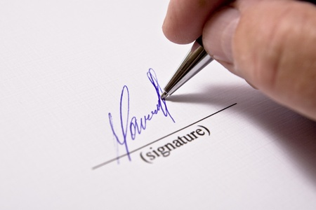 Man signing papers. The signature. photo