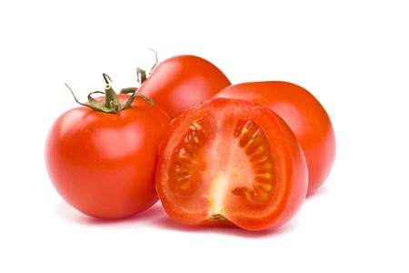 stipe: Ripe red tomatoes on a white background with clipping path. The focus is on the sliced tomato in front.