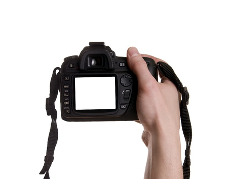 Photo camera in hand isolated on white background Stock Photo