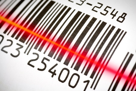 bar code: Package tracking barcode being read by a scanner.  Stock Photo