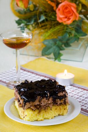 Sweet cake and glass of wine in romantic atmosphere photo