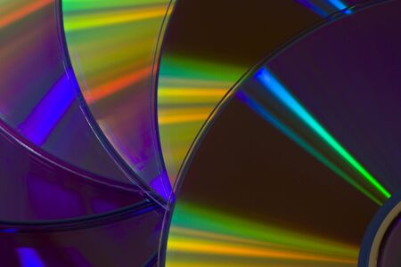 Many colorful DVD lying upon each other - landscape format Stock Photo - 10744442