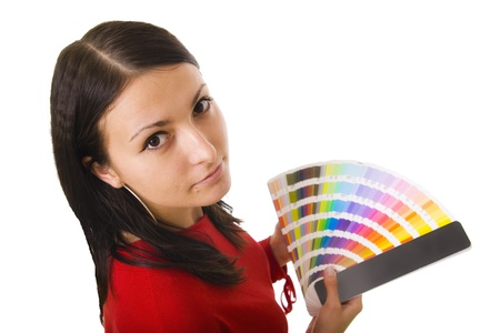uncoated: Stock photo of a young woman holding color guide Stock Photo