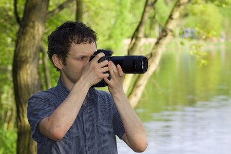 Sneaky photographer getting his shot of nature photo