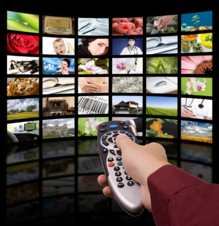 watching tv: LCD TV panels. Television production technology concept. Remote control. Stock Photo