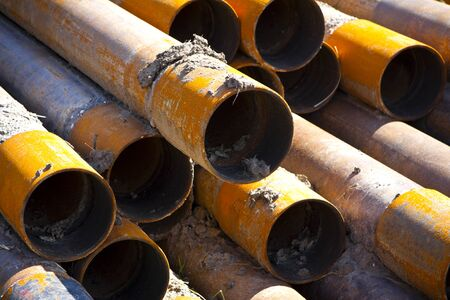 a stack of rusty steel pipes photo