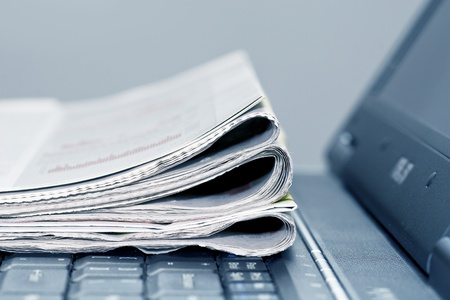newspapers on the laptop photo
