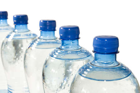quench: A row of bottles of water isolated on white  Stock Photo
