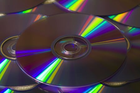 Many colorful DVD lying upon each other - landscape format photo