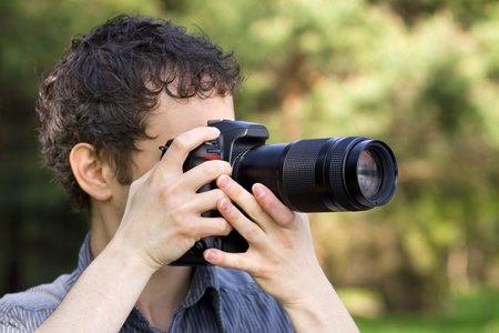 human photography: Sneaky photographer getting his shot of nature Stock Photo