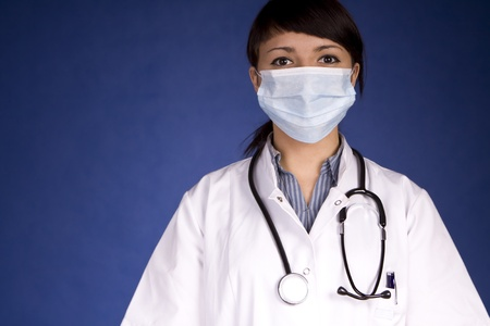 Woman Doctor Wearing A Mask Examining You photo