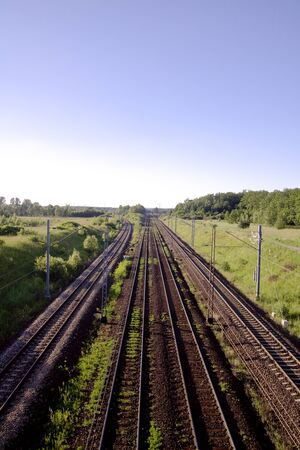 onward: Railway track leading far onward. Railroad tracks in Poland.