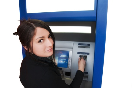 Woman withdrawing money from credit card at ATM photo