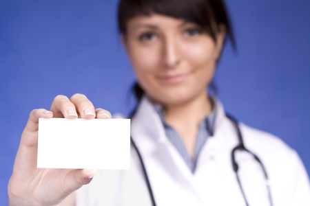 Women Doctor holding blank business card. Focus on fingers and card. Stock Photo - 12054751