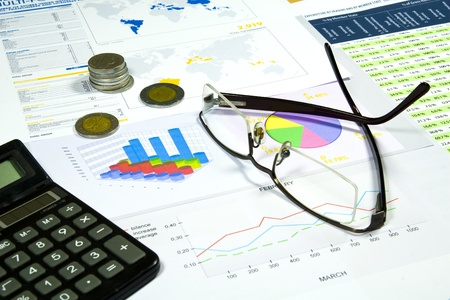 business advisor: Calculator, glasses and money in finance analyzing Stock Photo