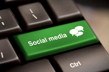 Social Media button on a keyboard with speech bubbles. Stock Photo - 12228452