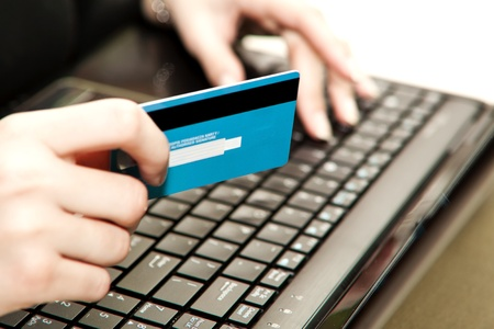 data entry: Hands entering credit card information into a laptop Stock Photo