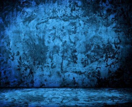 blue empty room with grunge concrete wall and cement floor photo