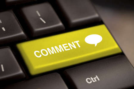 commentary: yellow comment enter key and speech bubble icon  Stock Photo