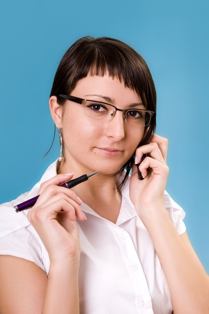 Businesswoman working, holding a cellphone Stock Photo - 12884945