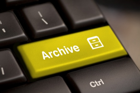 filing cabinet: the yellow archive enter button key Stock Photo