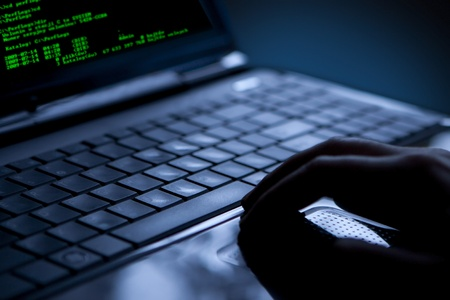 identity protection: Hacker using laptop  Lots of digits on the computer screen