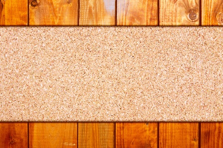 Cork board at wooden panel wall inter background Stock Photo - 12887276