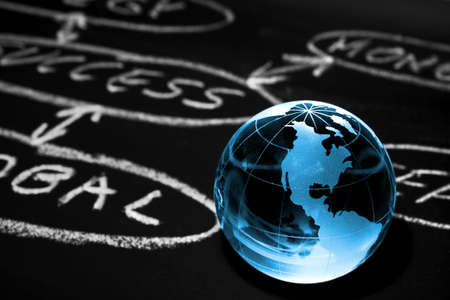 Flowchart on a chalk board with world globe showing America Stock Photo - 12885629