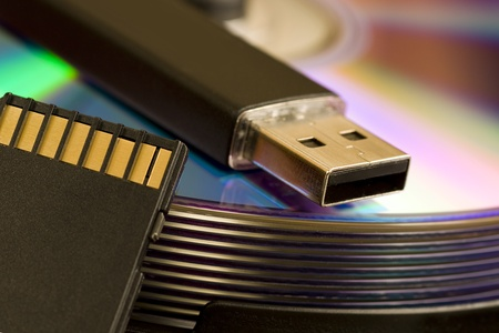 devise: Cds and usb devise with Camera SD card Stock Photo