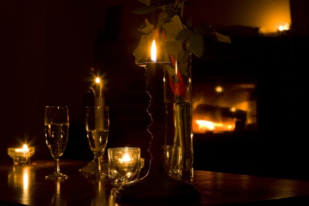 glasses with wine in front of fireplace, natural fire as a background photo