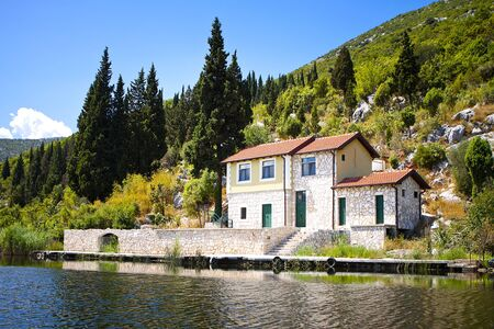 lake house: Lakefront Property  Cabin on the lake in Croatia   Stock Photo