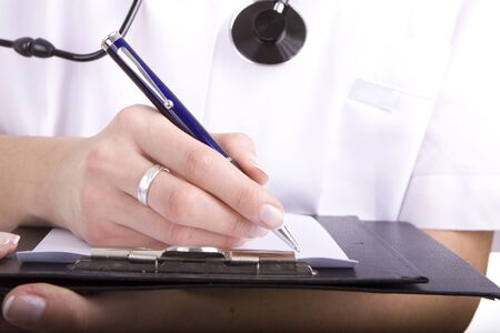 Healthcare professional, doctor or nurse, writing with a fountain pen on a paper over a folder  photo