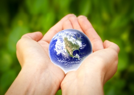 earth hands: human hands carefully holding Earth planet  Glass World