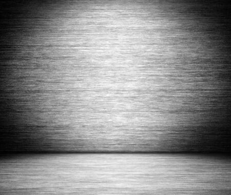 gray brushed metal texture in background photo